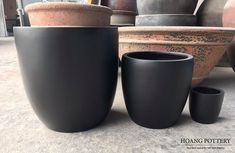 A set of four durable, lightweight cup-shaped poly/fiberglass planters painted in pure black (45cm*45cm, 33cm*33cm, 22cm*22cm, 16cm*16cm).  Website: www.hoangpottery.com  #hoangpottery #polyplanters #polypots #fiberglassplanters #fiberglasspots #gardendecoration #outdoordecoration #indoordecoration #decor Fiberglass Planters, Serving Bowls, Shapes, Pure Products, Website, Tableware, Outdoor Decor, Black, Dinnerware