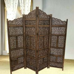 Benzara Brown Hand Carved Foldable Wooden Partition Room Divider - The Home Depot Room Divider Headboard, Wood Room Divider, 4 Panel Room Divider, Sliding Room Dividers, Divider Walls, Divider Cabinet, Wooden Partitions, Room Partitions, Wooden Screen