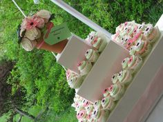 Cute bridal shower cupcake tower with cupcake bouquet