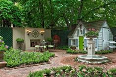 what a dream!  quaint cottage style potting shed, gorgeous outdoor fireplace w/seating area, private courtyard, planting areas & brick pavers!