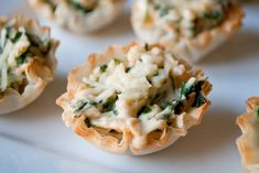 These Spinach and Artichoke Cups are a super easy appetizer that your guest will love. They are a great finger food!