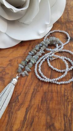 Long beaded grey tassel necklace. Long tassel necklace with gemstones…