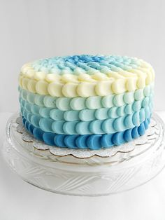 A blue ombre cake made for my nephew's baby shower. My first time trying the petal technique, it's easier than it looks! See it HERE! Blue Ombre Petal Cake submitted by Culinary Couture You May Also LikeBeet CakeGooey Baked S'mores BarsPink and Green Vanilla CupcakesRose Ombre Cake (Lemon Cake with White Chocolate buttercream)