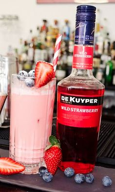 Pink Panther Cocktail Recipe: - 1 Part  Licor 43 - 1 Part Milk - Dash De Kuyper Strawberry Glass: Highball Ice: Cubed Method: Shaken Garnish: Strawberry and blueberry