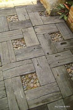 Check out this great idea for a decorative walkway or patio space at the cottage. A great way to recycle old wood as well.