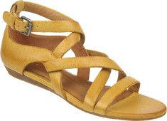 Hillary is a fun strappy sandal with a low wedge heel and covered back.