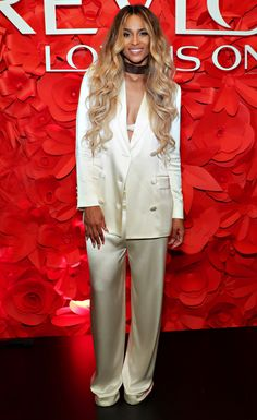 Ciara in a white satin suit and choker