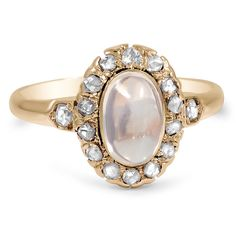 The Nelia Ring.  This majestic Art Deco ring displays an oval-shaped moonstone at the center of a sparkling rose cut diamond halo.