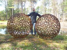 [Stemwinder Sculpture Works & Gardens] Artist Jay Sawyer creates garden art sculptures of steel. Many of his sculptures are these intriguing globes. Other sculptures use found objects.