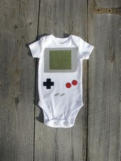 So something Robert would want for a boy. Nintendo Gameboy Baby Clothes by TheWishingElephant on Etsy, $18.00
