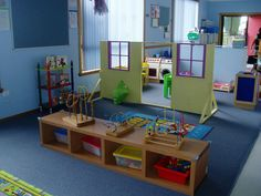 I love the wooden house divider! It's such a cute way to define dramatic play space. Home Daycare Rooms, Daycare Spaces, Home Childcare, Preschool Rooms, Kids Daycare, Daycare Ideas, Playroom Ideas, Home Learning, Learning Spaces