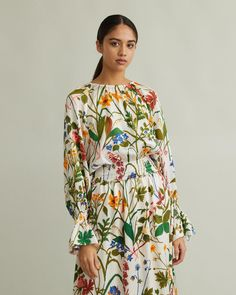 """Slouchy silhouette blouse with over-dimensional sleeves and fitted waist, cut in a hammered silk featuring the iconic """"Ros och Lilja"""" (Rose and Lily) print, created by Swedish artist Gocken Jobs in Retail Concepts, Cool Suits, Floral Tops, Apothecary, Silk, Blouse, Long Sleeve, Silhouette"""