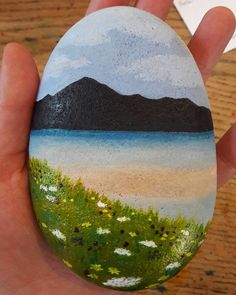 Painting on pebbles again today. This time a Hebridean view and some machair! #patternsoflight #kishorn #westerross #highlands #scotland #scottishart #scottishartist #pebbleart #hebrides #machair