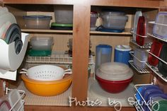 More tupperware planning tips: -This lady adds wire racks to doors and actually pairs up lid and container for ease of use. -Holds the shelves up w hooks bec cant hook them directly onto the door.  -Uses duck tape to seal the bottom and prevent lids from slipping through -Creates shelf in the cupboard by popping one of the wire ones upside down