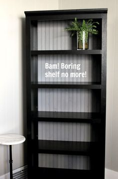 DIY: upgrade a cheap pre-fab bookcase by replacing the back with painted strips of beadboard.