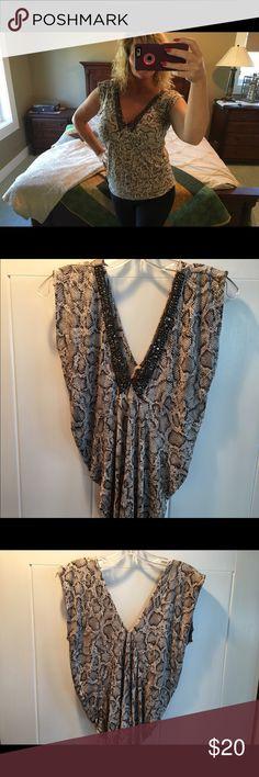 ⬇️Velvet brand brown snakeskin top Velvet brand brown snakeskin style top with beaded v-neck. Velvet Tops Blouses