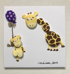 Painted pebble art, painted stone art, giraffe mother and her baby. Great baby shower gift, Mother's Day gift.