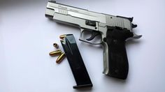 Sig Sauer P226 pistol in stainless Find our speedloader now! http://www.amazon.com/shops/raeind