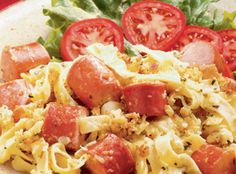 Hot Dog Noodle Casserole  Inn Maid Wide Egg Noodles are mixed with hot dogs and a cheesy sauce then topped with toasted, crumbled buns for a taste of summer any time of the year.   From Marzetti Kitchens℠.