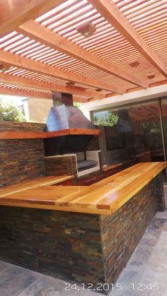 If you have the space in your yard, check out the outdoor kitchen ideas total with bars, seating areas, storage space, as well as grills. Outdoor Kitchen Grill, Outdoor Kitchen Design, Outdoor Cooking, Outdoor Kitchens, Modern Kitchens, Kitchen Modern, Outdoor Spaces, Outdoor Living, Outdoor Decor