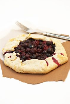 Mixed Berry Galette is a rustic tart with a berry or fruit center. Dough, two hands and some berries infused with almond extract are all you need!