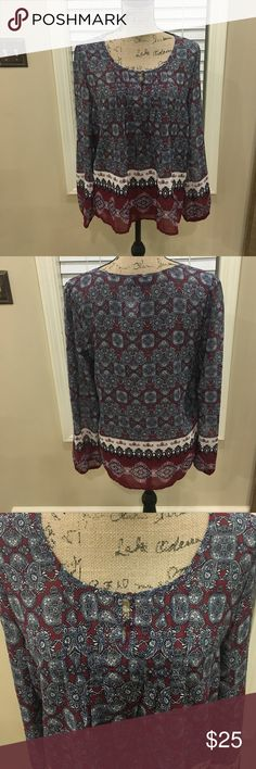 "Boutique BOHO-chic lovely flowy blouse NWT. Boutique BOHO-chic lovely flowy blouse NWT. This is a lovely blouse with two buttons at the neck, along with some gathering across the bust for style points! Stunning paisley tyke pattern. Deep burgundy, navy, and white. Long sleeved with elasticized wrists. Slightly sheer. May require a cami or sexy bralette for some. Pit to pit measurement is 20"". Length is 27"". boutique Tops Blouses"