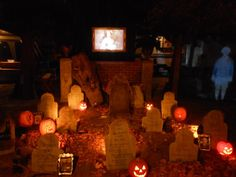 The graveyard, ghost on right, and picture projected above graveyard wall.  Scary stuff!!
