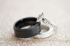 Groom's black tungsten wedding band and Bride's silver, marquise engagement ring with surrounding diamonds and her silver pave wedding band | Lasting Images Photography | villasiena.cc