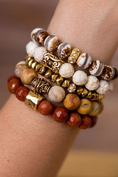 Add a touch of nature to any outfit with this unique stack of beaded bracelet designed and handmade in the South featuring semi-precious gemstones and gold accents. Each stack is carefully put togethe