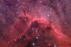This amazing skyscape lies along a bright ridge of emission in IC 5067, also known as The Pelican Nebula. Appropriately, the Pelican Nebula itself is part of a much larger, complex star-forming region about 2,000 light-years away in the high flying constellation Cygnus, the Swan. Cosmic dust clouds that span light-years seem to rise like mountains in the mist in this natural color view, recorded through broadband filters to produce an analogy to human color vision.