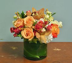 This arrangement brings a little warmth to the cool Autumn air with sweet peach roses, hot pink roses and buttery yellow stock.