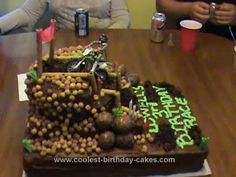 Homemade Motocross Birthday Cake: This Motocross Birthday Cake was made from box cake mixes, using the pudding/fudge in them to make them heavier.  The bottom layer is two fudge sheet cakes,