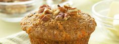 Carrot Spice Muffins | These spicy, tender and moist muffins taste just like carrot cake in disguise. They're bursting with nuts and raisins, and taste great with a streusel topping.