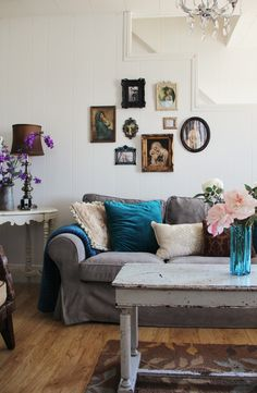 WANT grey sofa  love the coffee table  PAINT my table (on left of couch) white!