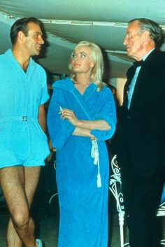 "Sean Connery and Shirley Eaton meet author Ian Fleming on the set of ""Goldfinger"", 1964"