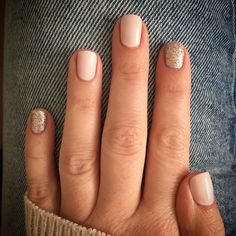 Pale nude pink nails with champagne glitter