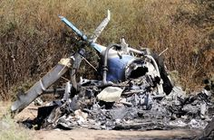 A view of the charred wreckage of the two helicopters which collided in the region of Villa Castelli, in the Argentine province of La Rioja March 10, 2015. France mourned on Tuesday the deaths of three sports stars who were among 10 people killed when two helicopters collided in a remote region of Argentina during the filming of a reality TV show. Investigators removed the bodies of Olympic swimmer Camille Muffat, yachtswoman...