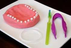 Learn about dental health and pretend to be a dentist with this dentist play dough invitation for preschoolers.
