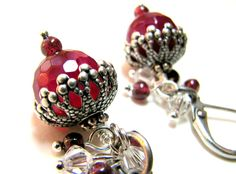 Victorian inspired Winter Berry Earrings with red ruby 10mm beads that I capped with silver ox filigree. I wire wrapped a cluster of tiny garnets and clear crystals to embellish. So pretty!