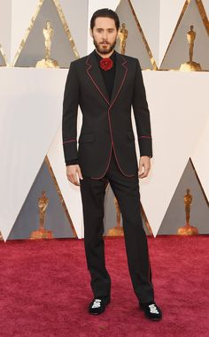 Jared Leto from Best Dressed Men at the 2016 Oscars  The always adventurous Jared Leto brought his fashion A-game. The outlined Gucci black blazer and red flower tie replacement is incredibly cool.