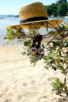 Straw Hat and Sunglass with Seascape Royalty Free Stock Photo