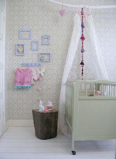 nursery  // claradeparis.com loves the branch curtain holder