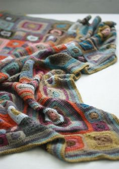 gorgeous colors in this crochet granny square blanket