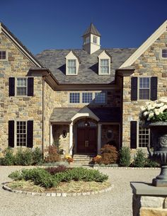 Love the color of the STONE used for the home & like the design of the pea-gravel circular driveway at main entrance.