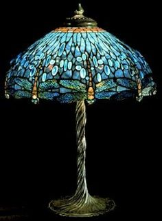 i don't usually like tiffany lamps, but this one is particularly unique, a beautiful color, and a true art piece! comment by @krissy knox