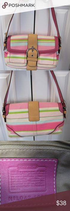 "Gently Used Authentic Coach Hobo Multi Color Gently Used Authentic Coach Hobo Multi Color Stripes Reversible Handle Pink/tan Canvas/leather..Small....Very minimal wear ...in beautiful shape.10""W...6.5"" on height...Strap drop measures 7.5"". ..Depth 3.5""..Comes with Coach dust bag. Coach Bags Mini Bags"