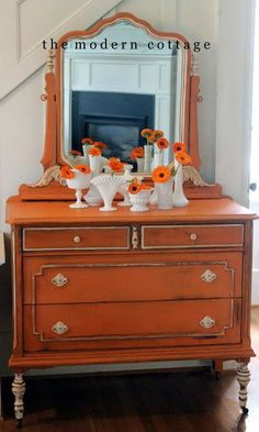 barcelona orange dresser, white milk paint legs, white hardware, painted  mirror.  Probably my favorite MCC piece.