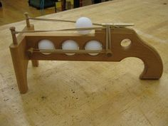 Ping Pong Shooter! The boys would love this if mary darlin would ok it lol