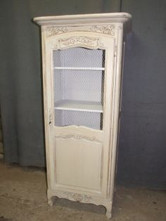 Fantastic robins egg blue French country Cabinet with chicken wire door. Lesmeeksauctions.com