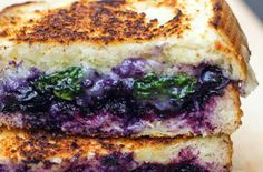 Balsamic blueberry grilled cheese is filled with flavors from the Pacific Northwest.  Two thick pieces of white bread are slathered with balsamic blueberry compote and then stuffed with spinach and cheese.